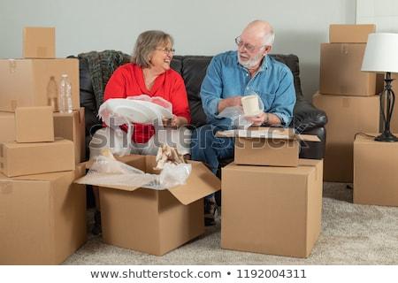 Stockfoto: Senior Adult Couple Packing Or Unpacking Moving Boxes