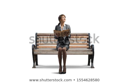 beautiful young woman holding open book and reading on bench stock photo © boggy