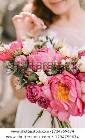 Esküvői csokor kezek menyasszony fehér ruha virág esküvő Stock fotó © ruslanshramko