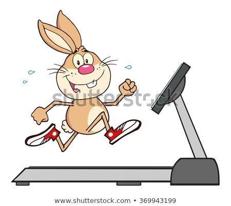 smiling rabbit cartoon character running on a treadmill stock photo © hittoon