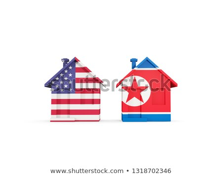 two houses with flags of united states and north korea stock photo © mikhailmishchenko