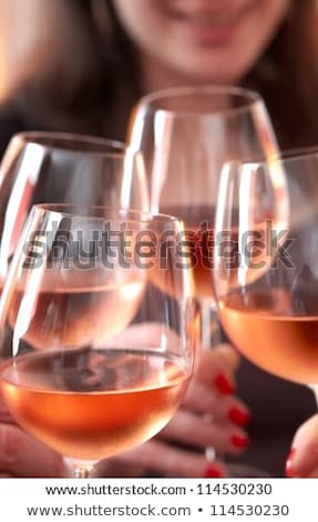 Closeup of four glasses with rose wine being clinked together  Stock photo © dashapetrenko