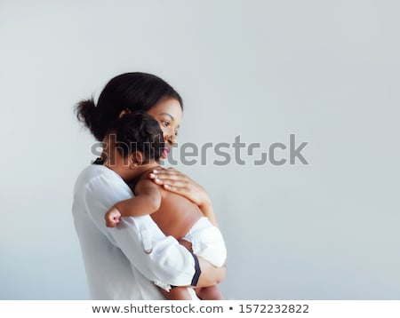 Proud Parents Holding Baby in the bedroom Stock photo © Lopolo