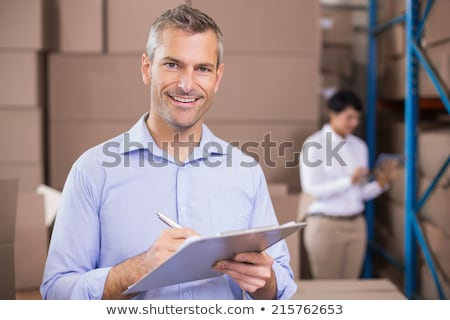 mooie · magazijn · manager · inventaris · notepad · business - stockfoto © lopolo