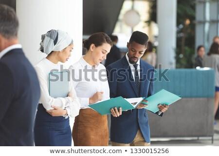 Elöl kilátás fiatal sokoldalú üzletemberek néz Stock fotó © wavebreak_media