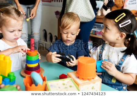 Children in nursery school learning and playing Stock photo © Kzenon