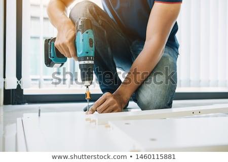 Male Carpenter Installing Drawer Stock photo © AndreyPopov