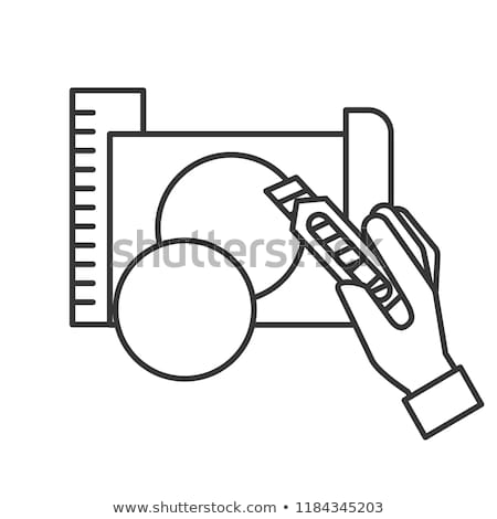 hand holding cutter making circle with paper Stock photo © yupiramos