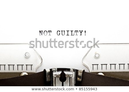 Stock photo: Typewriter NOT GUILTY
