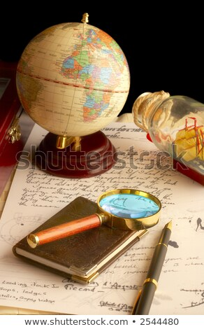 The globe, magnifier with a notebook and the old manuscript.  Stock photo © cookelma