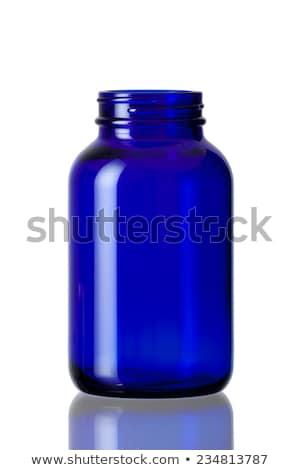 Bottle, glass and blue pills Stock photo © almoni