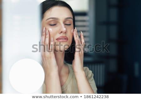 Káprázatos barna hajú fürdő nő hidratáló portré Stock fotó © lithian