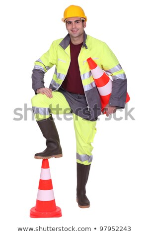 Worker with foot on top of cone signaling Stock photo © photography33