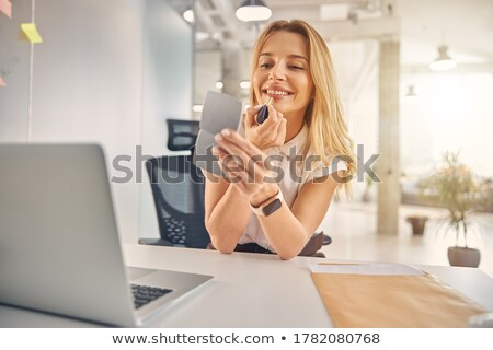 Young blond woman displaying elegant makeup. Stock photo © lithian