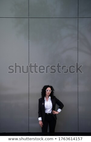 woman with her hands on her hips standing in an architects office stock photo © photography33