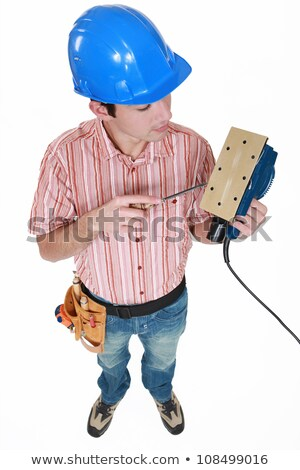 high angle shot of young carpenter holding sander machine Stock photo © photography33