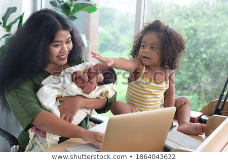 mother and daughter sat at laptop stock photo © photography33