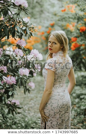 lovely girl with green eyes looking over shoulder Stock photo © dolgachov