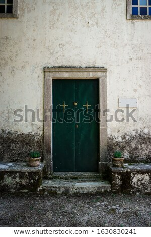 An old wooden door, in the stone wall of an old 14th Century church Stock photo © TheFull360