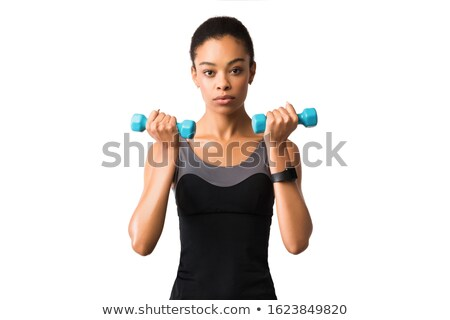 female doing bicep curls stock photo © sumners