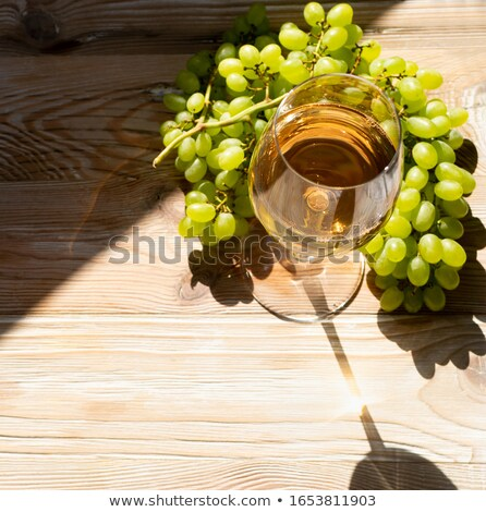 Stock photo: Golden wine in the sun on a rustic table