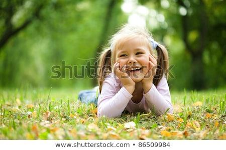 happy little girl in autumn park stock photo © anna_om