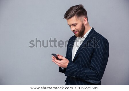happy business man reading an SMS on smartphone Stock photo © feedough