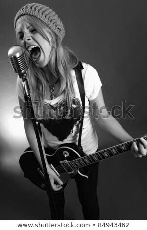 Guitarist screaming into old microphone Stock photo © sumners