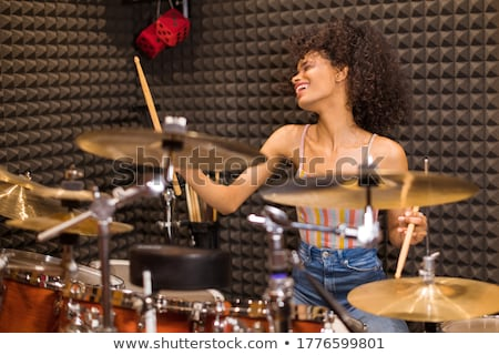 beautiful woman immersed in her music stock photo © stryjek