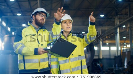 manual worker pointing to laptop stock photo © photography33