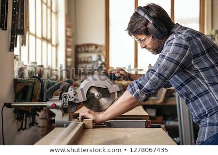 Tradesman using a circular saw Stock photo © photography33