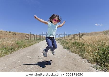 niña · feliz · amarillo · vestido · campo · floración · violación - foto stock © acidgrey