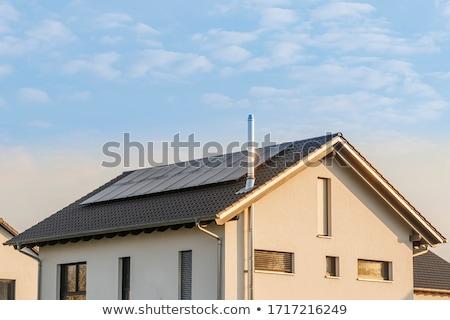 Komin dymu dachu panele słoneczne niebo Zdjęcia stock © manfredxy