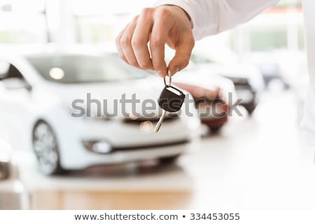 Dealer holding car keys by his fingertips in a dealership Stock photo © wavebreak_media