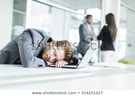 Businessman asleep at desk Stock photo © photography33
