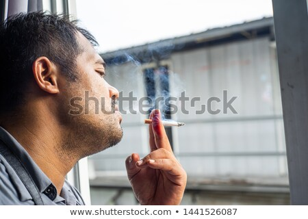 Adult Bum Lighting a Spliff Stock photo © eldadcarin