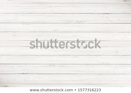 Old grunge plywood board on a wooden wall Stock photo © photocreo