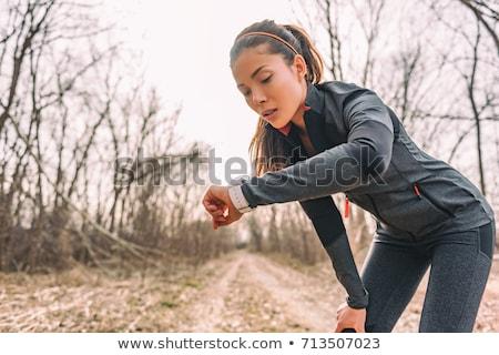 Iz koşucu harita genç kadın çalışma dağlar Stok fotoğraf © blasbike