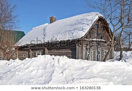 small wooden house on the white fresh snow stock photo © dashapetrenko