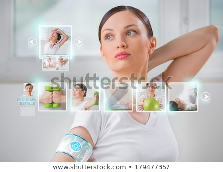 Woman doing exercise wearing smart wearable device with futurist Stock photo © HASLOO
