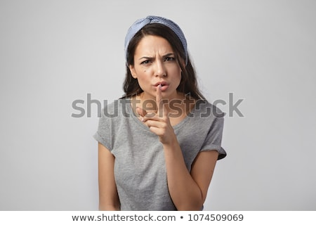 young woman asking for silence stock photo © alexandrenunes