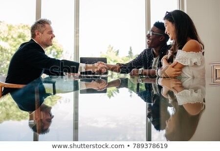 Estate Agent Discussing Property With Client In Office Stock photo © HighwayStarz