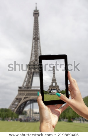 Taken pictures Eiffel Tower with mobile phone Stock photo © smuki