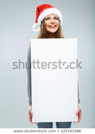christmas woman hold big white card copyspace stock photo © hasloo