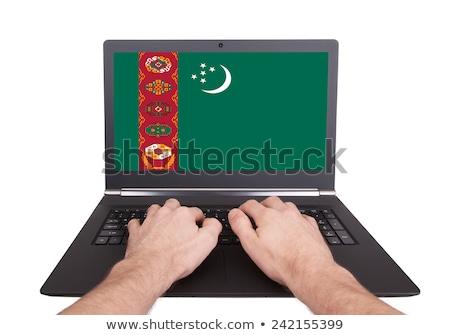 Kezek dolgozik laptop Türkmenisztán mutat képernyő Stock fotó © michaklootwijk