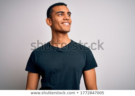 portrait of a laughing african man looking away over white background stock photo © deandrobot