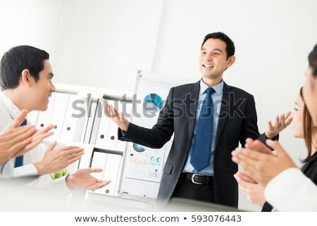 Happy man making a presentation Stock photo © iko