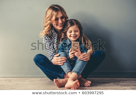 little girl using mobile phone stock photo © witthaya