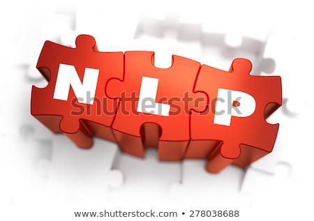 NLP - White Word on Red Puzzles. Stock photo © tashatuvango