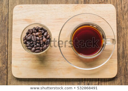 cup of espresso with coffeebeans stock photo © hofmeester